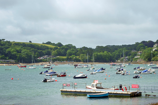 The view across the picturesque Helford River where many small boats are moored