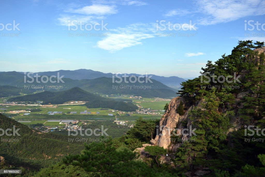 The view around Namsan Mountain. There's a carving of Buddha if you notice! stock photo