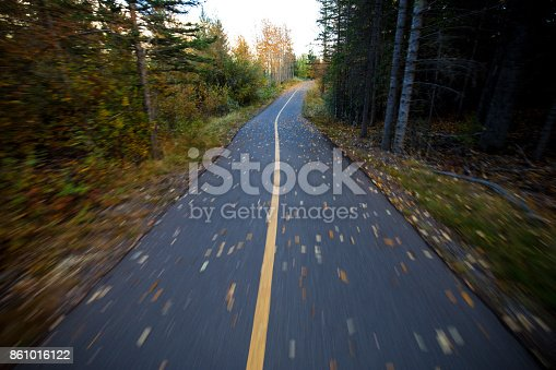 861018326 istock photo The view from a moving bicycle of a designated bicycle pathway in fall. 861016122