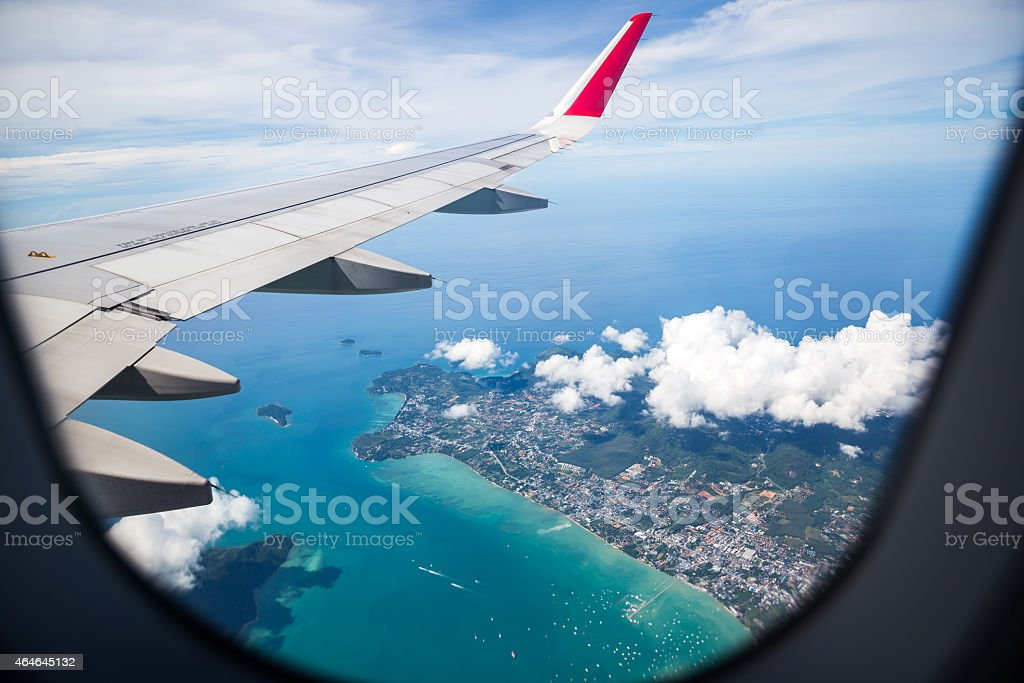The view from an airplane window overlooking the ocean stock photo
