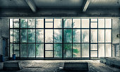 istock The view from an old, abandoned factory on the inside with nice window light 833383790