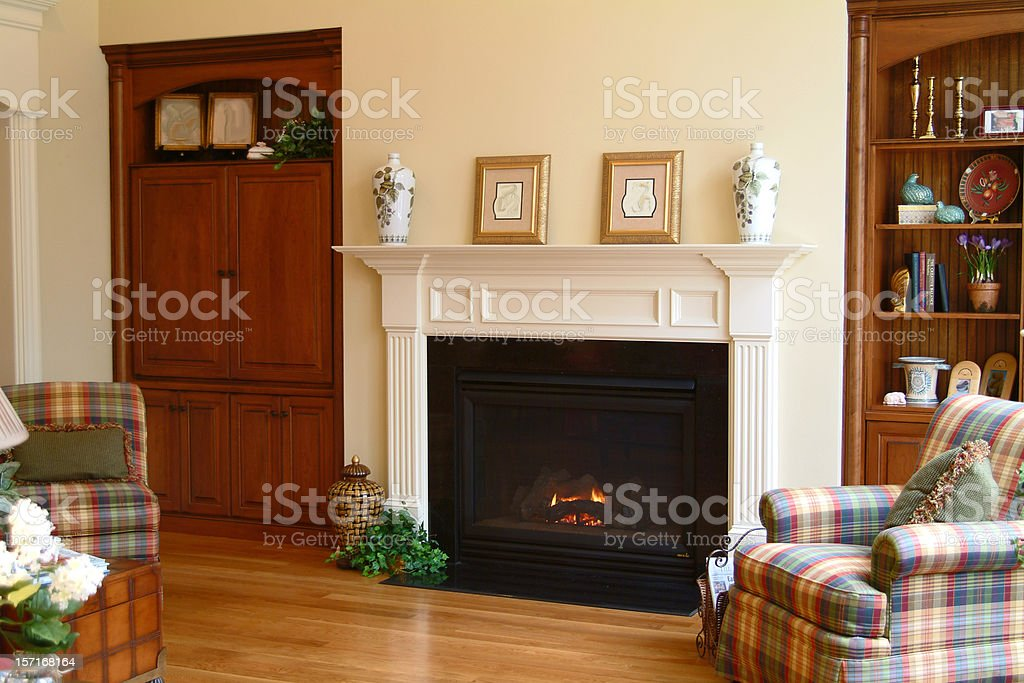 The view of a cozy living room and fireplace royalty-free stock photo