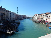 The ballustrades, arcade and delicate renaissance arch of the most iconic symbol of Venice, the 16th Century Rialto Bridge across the Grand Canal in the centre of Venice, Italy
