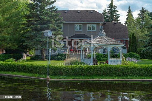 Ontario, Canada - June 27,2019: Residentials on both shores of the canal in  Lagoon City at Lake Simcoe in Ontario, Canada.