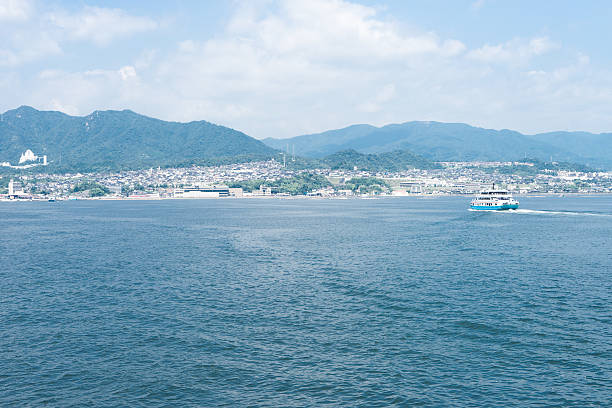 The view of Miyajima ferry, Miyajima guchi and Hatsukaichi, Japan The view of Miyajima ferry, Miyajima guchi and Hatsukaichi, Japan itsukushima shrine stock pictures, royalty-free photos & images