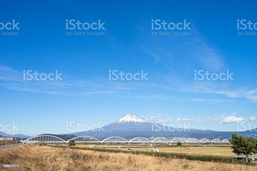 The view of Mt. Fuji and Fuji River bridge stock photo
