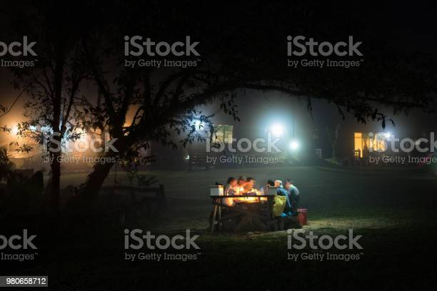 Photo of The view of natural landscape with village on hill in winter time with fog and mystic atmosphere. Winter beautiful starry night landscape. Camping in the winter forest in the mountain.