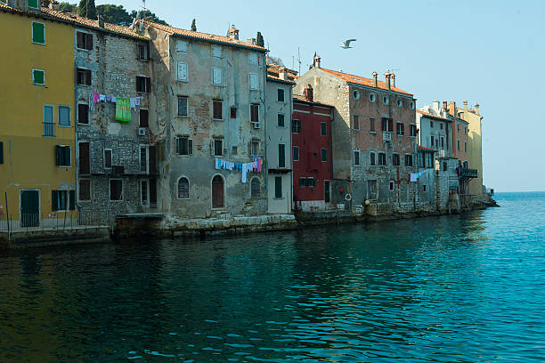The view of Rovinji the houses on the sea in Rovinji, Croatia. royce lake stock pictures, royalty-free photos & images