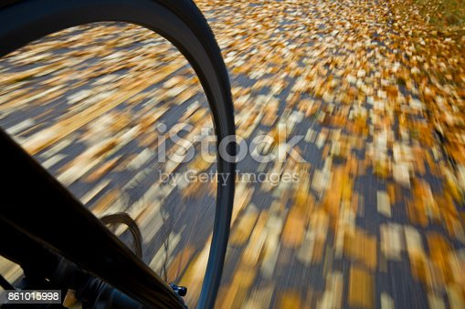 861018326 istock photo The view of the front wheel of a cyclo-cross commuter bike and the aspen leaves on a bicycle pathway in fall. 861015998