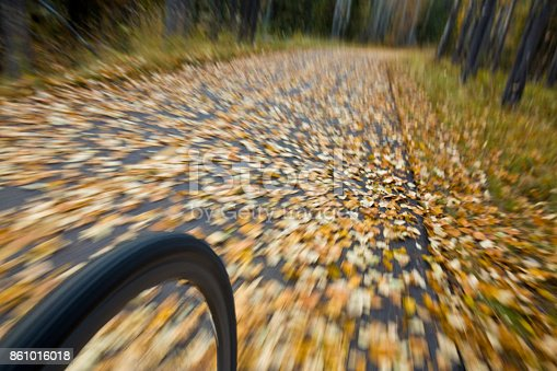 861018326istockphoto The view of the front wheel of a cyclo-cross commuter bike and the aspen leaves on a bicycle pathway in fall. 861016018