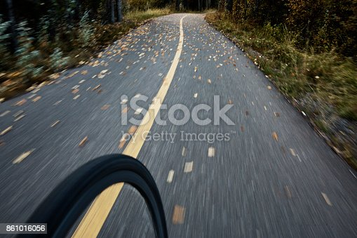 861018326 istock photo The view of the front wheel of a cyclo-cross commuter bike and the aspen leaves on a bicycle pathway in fall. 861016056