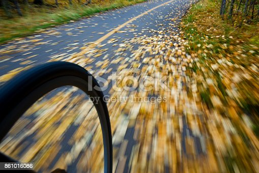 861018326 istock photo The view of the front wheel of a cyclo-cross commuter bike and the aspen leaves on a bicycle pathway in fall. 861016086