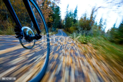 861018326 istock photo The view of the front wheel of a cyclo-cross commuter bike and the aspen leaves on a bicycle pathway in fall. 861016118