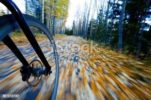 861018326istockphoto The view of the front wheel of a cyclo-cross commuter bike and the aspen leaves on a bicycle pathway in fall. 861016182
