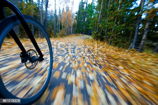 istock The view of the front wheel of a cyclo-cross commuter bike and the aspen leaves on a bicycle pathway in fall. 861018326