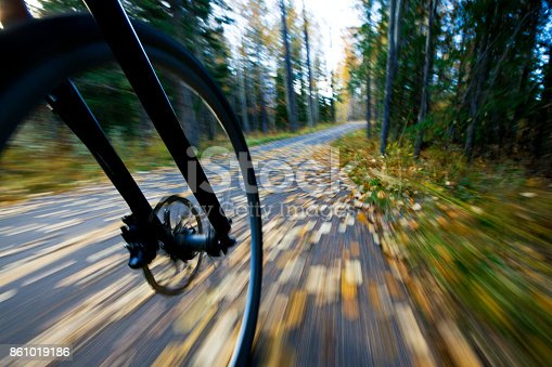 861018326 istock photo The view of the front wheel of a cyclo-cross commuter bike and the aspen leaves on a bicycle pathway in fall. 861019186