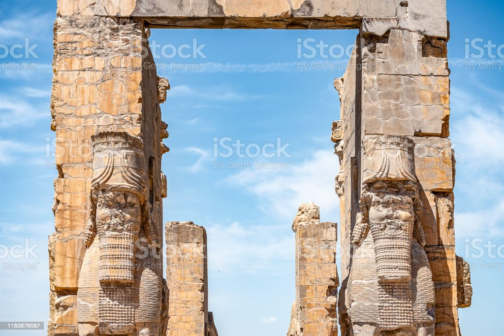 The view of the remaining ruins of the Gate of All Nations in Persepolis, the ancient capital of the Persian Persian Empire of the Hellenes, Province of Fars, Iran The view of the remaining ruins of the Gate of All Nations in Persepolis, the ancient capital of the Persian Persian Empire of the Hellenes, Province of Fars, Iran Ancient Stock Photo
