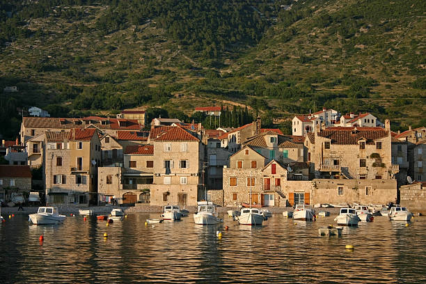 The view of the water, buildings, and boats in Vis town stock photo