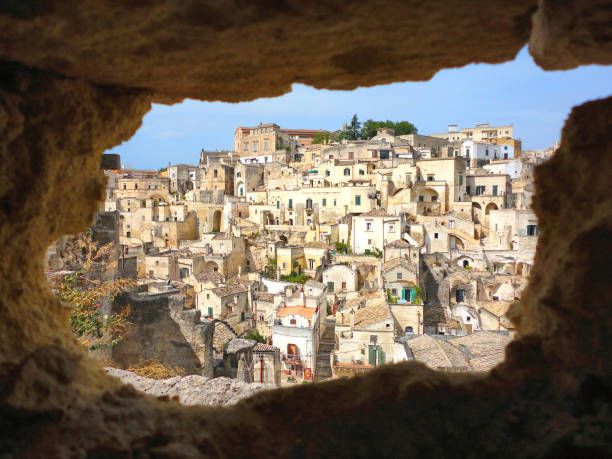 the view on the picturesque houses of the old city of Matera from the cave on the opposite hill, South Italy the view on the picturesque houses of the old city of Matera from the cave on the opposite hill, South Italy matera italy stock pictures, royalty-free photos & images