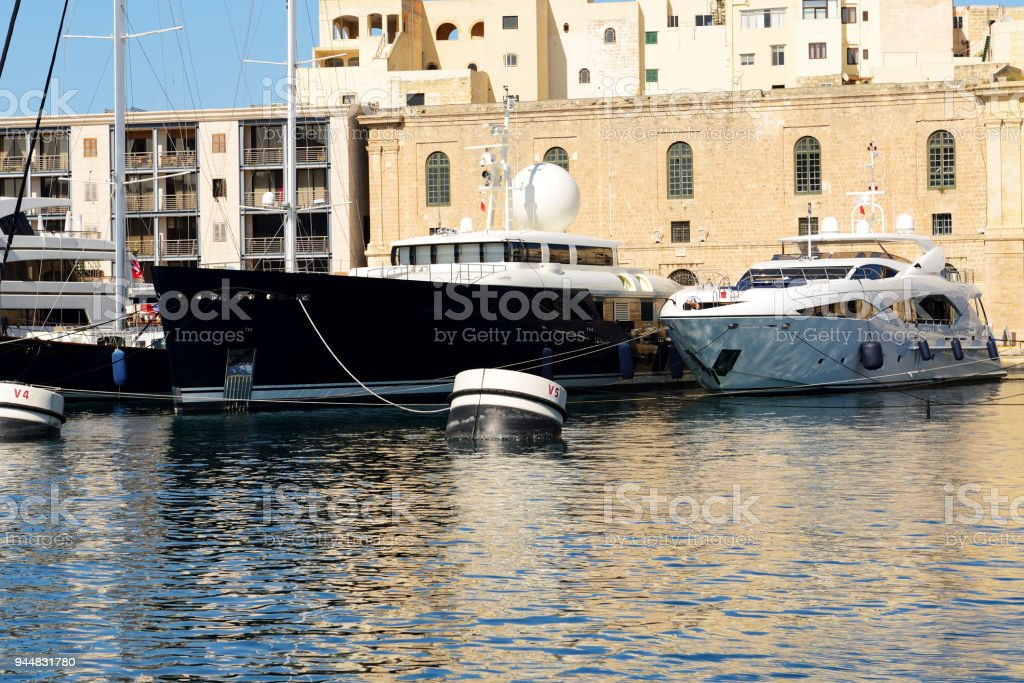 The view on Vittoriosa and modern yachts in sunset, Malta stock photo
