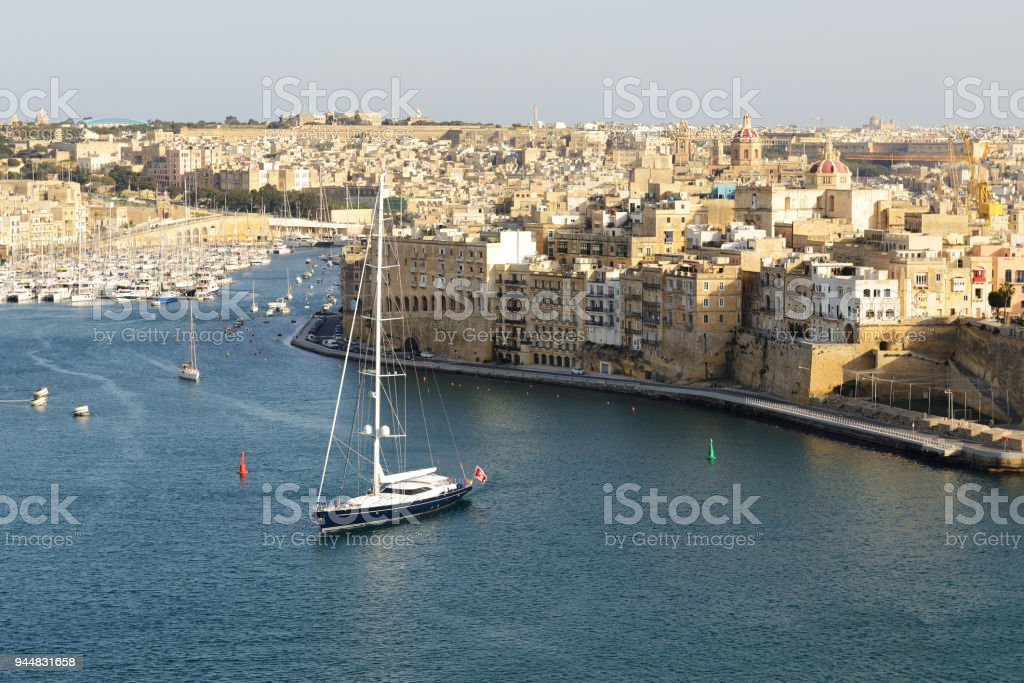 The view on Vittoriosa and yachts in sunset, Malta stock photo