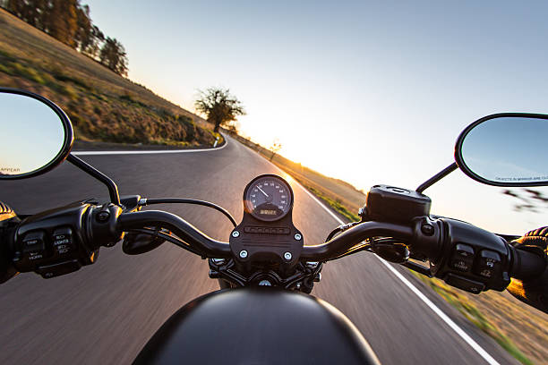 the view over the handlebars of motorcycle - motorcycle stock photos and pictures