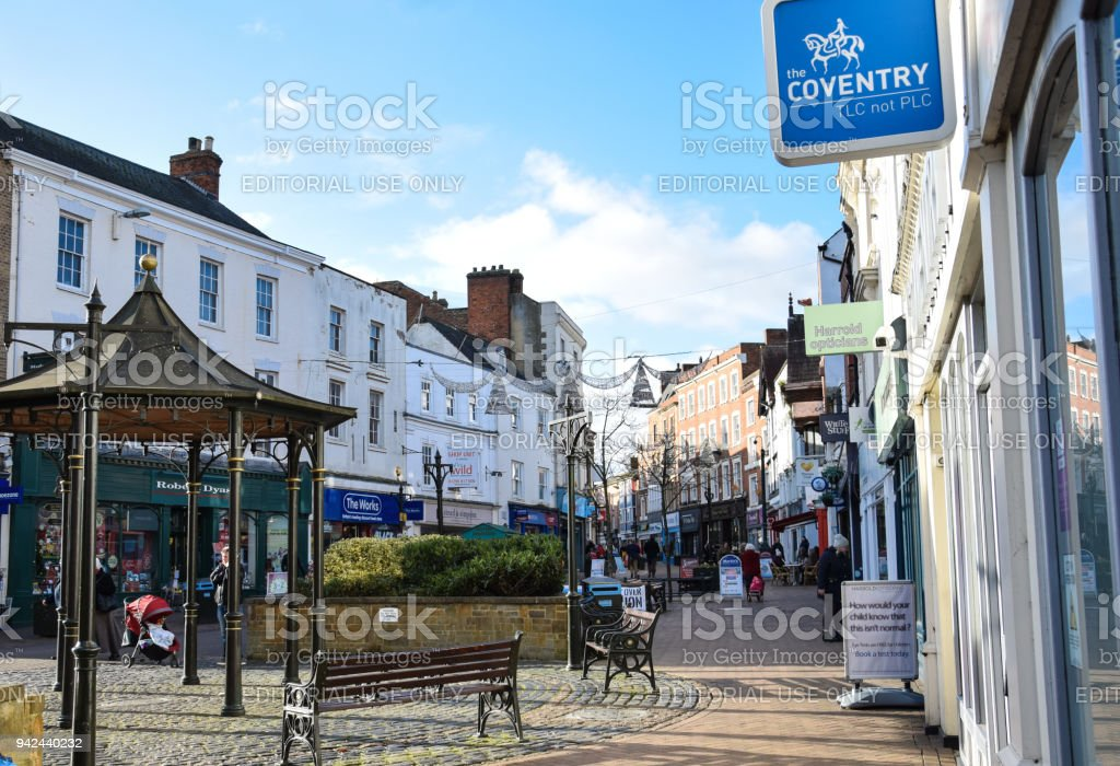 The view up Banbury High Street, with shoppers going in and out of shops in the run up to Christmas stock photo