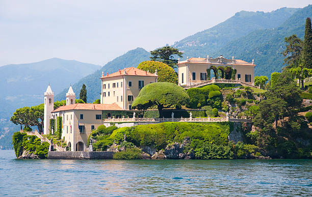 The Villa del Balbianello on Lake Como, Italy The Villa del Balbianello is a villa in the comune of Lenno (province of Como), Italy, overlooking Lake Como. It is located on the tip of a small wooded peninsula on the western shore of the south-west branch of Lake Como, not far from the Isola Comacina and is famous for its elaborate terraced gardens. villa stock pictures, royalty-free photos & images