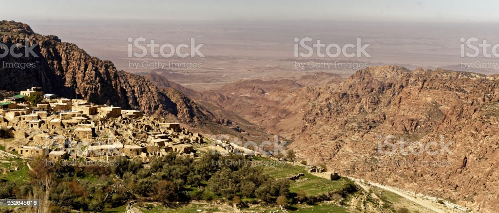 The village of Dana on the edge of the Dana Reserve, a deep valley cut in the south-western mountainous region of the Kingdom of Jordan, panoramic view stock photo