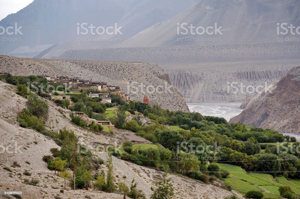 The village of Tangbe on the banks of the Kali Gandaki river in the valley of the Himalayan mountains. stock photo