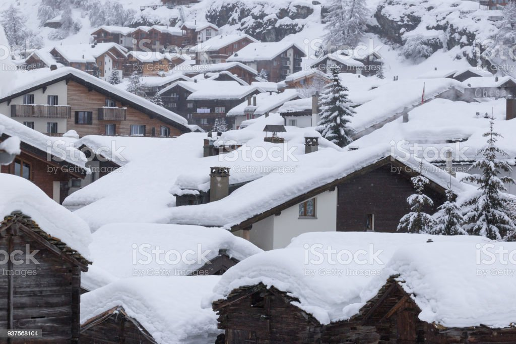 The village of Zermatt covered in a heavy layer of snow after a heavy blizzard stock photo