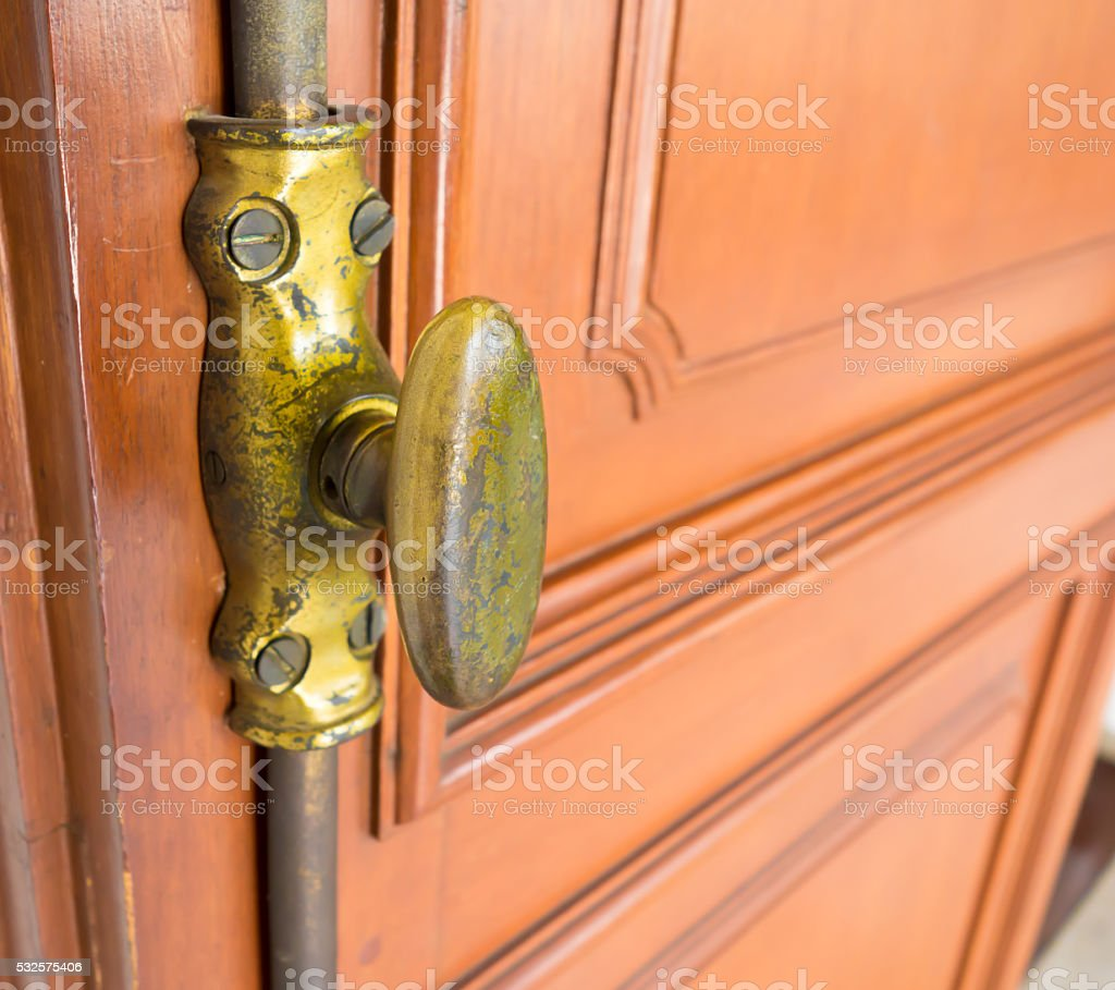 The Vintage wooden window with gold iron locked bolt stock photo