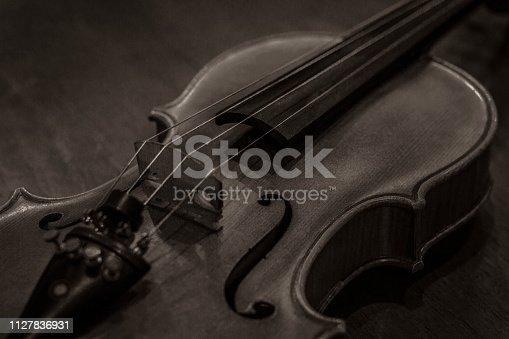 istock The Violin in a sepia color picture 1127836931