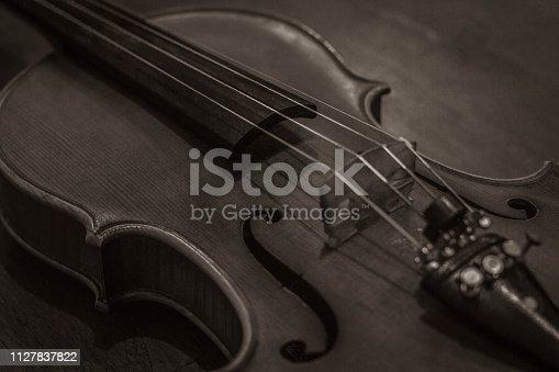 istock The Violin in a sepia color picture 1127837822