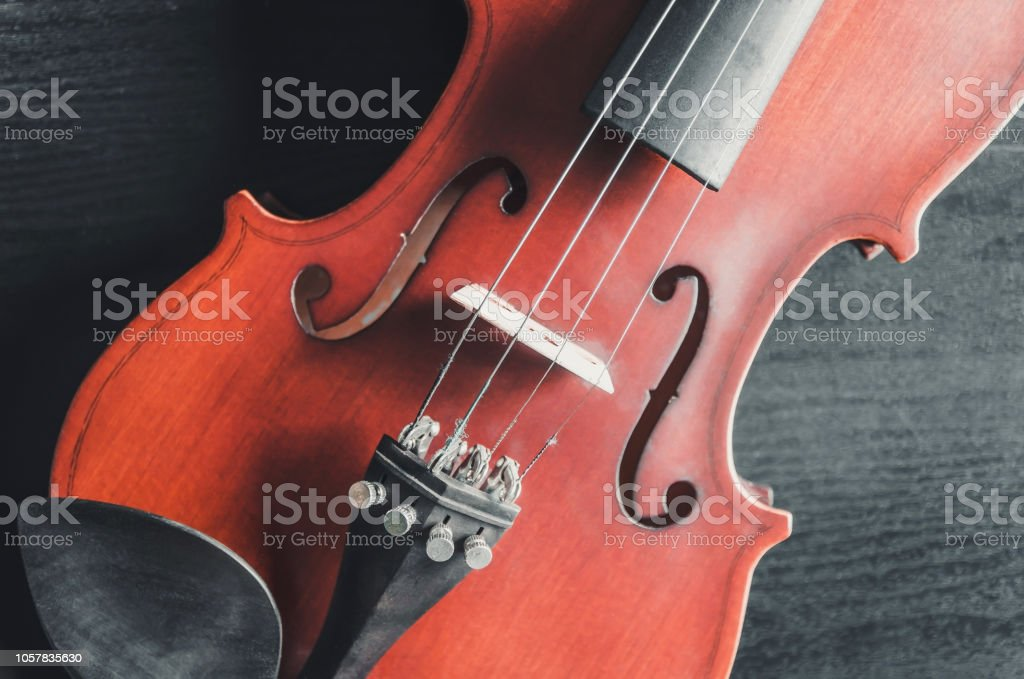 The violin on the dark table, Close - up of violin on the wooden...