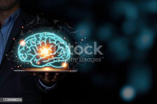 881350654 istock photo The virtual brain on tablet. Creative new business idea concept. 1226588024