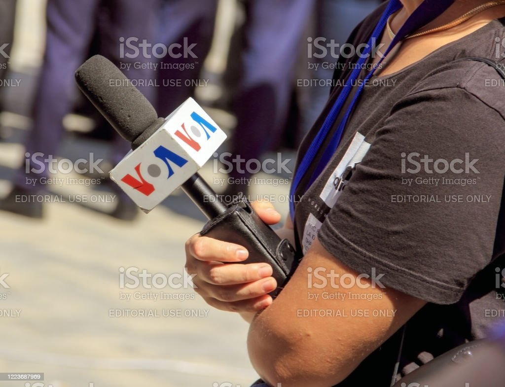 The VOA microphone on woman hand, interview concept. - Royalty-free Adult Stock Photo