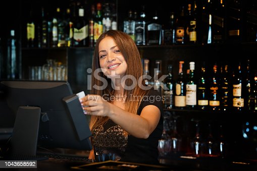 istock The waitress at the cash register 1043658592