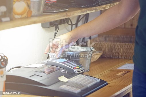 istock The waitress at the cash register 1054722568