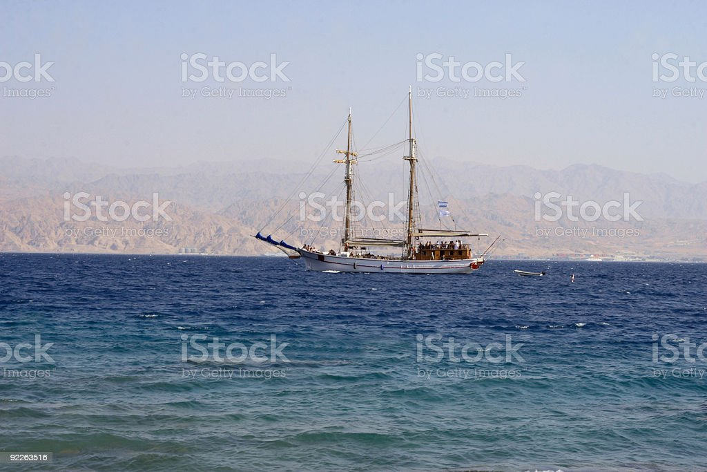 The walking ship with people on a deck royalty-free stock photo