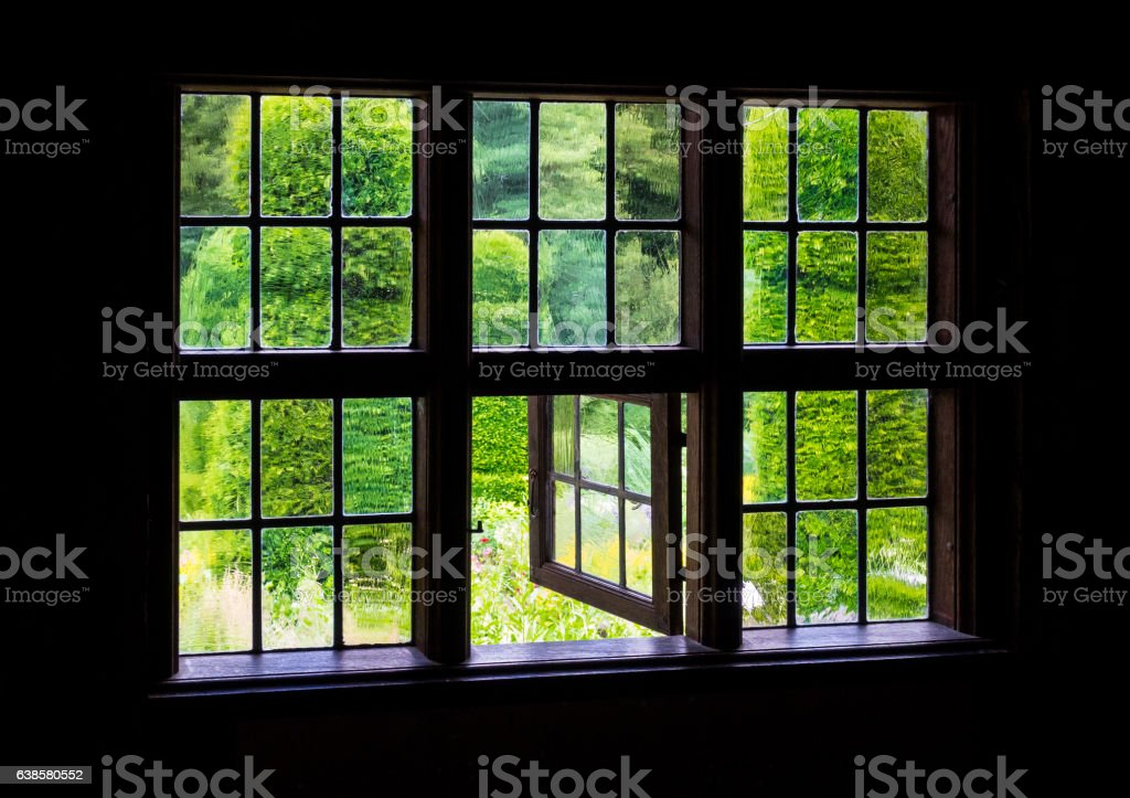 The Wall And Window Of An Old Farmhouse Inside Stock Photo