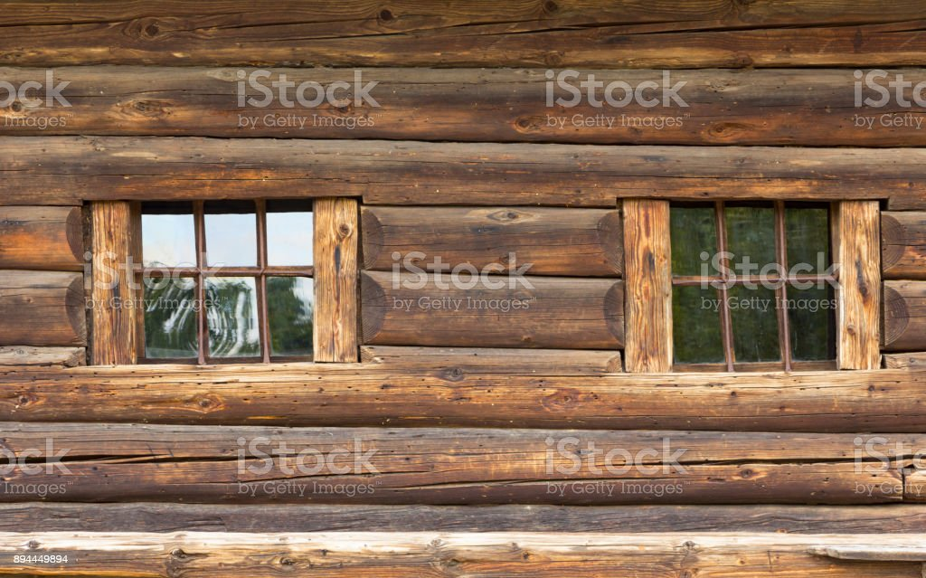 The wall of a very old house with a log house, with gray wood stock photo