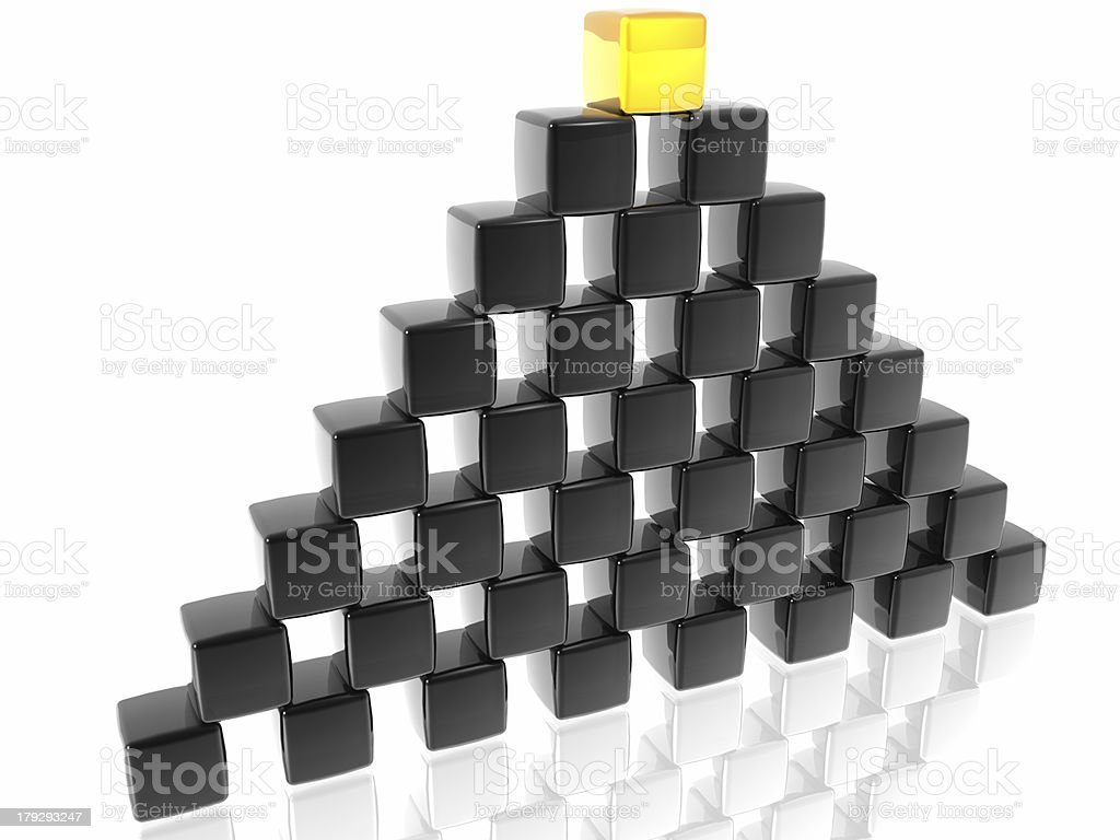 The wall of black blocks with golden one royalty-free stock photo