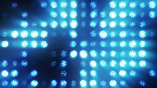 The wall of bright orange incandescent lamps lights up along the pattern The wall of bright orange incandescent lamps lights up along the pattern stage light stock pictures, royalty-free photos & images