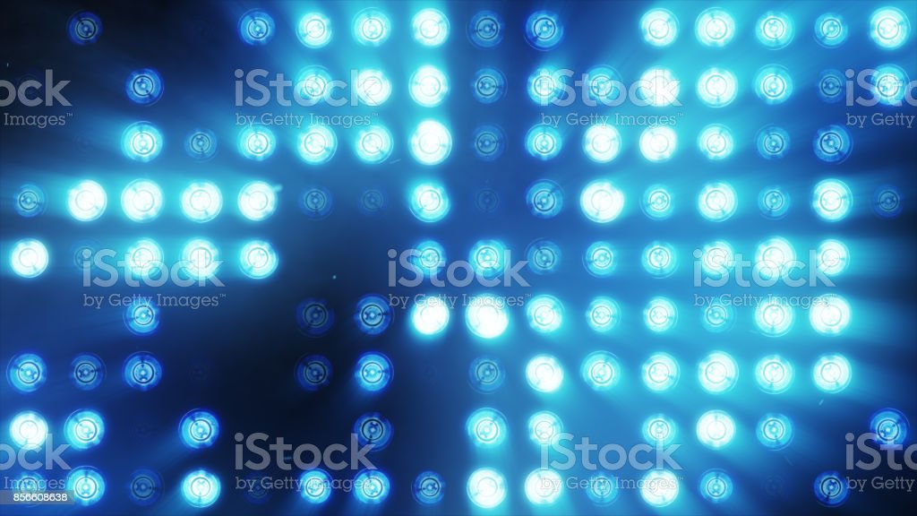 The wall of bright orange incandescent lamps lights up along the pattern stock photo