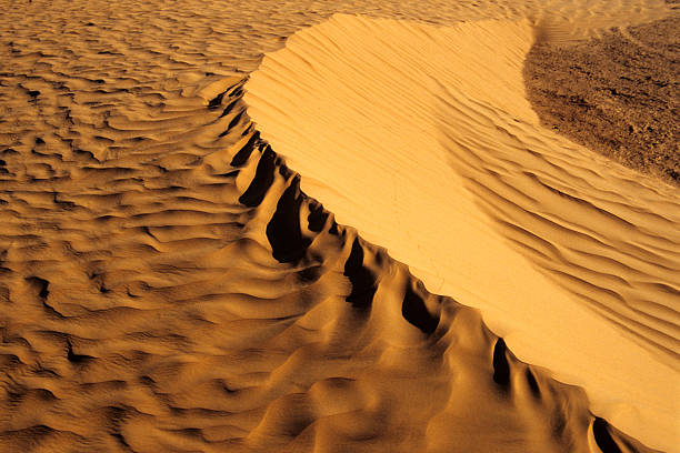 The wall of sand in the desert stock photo