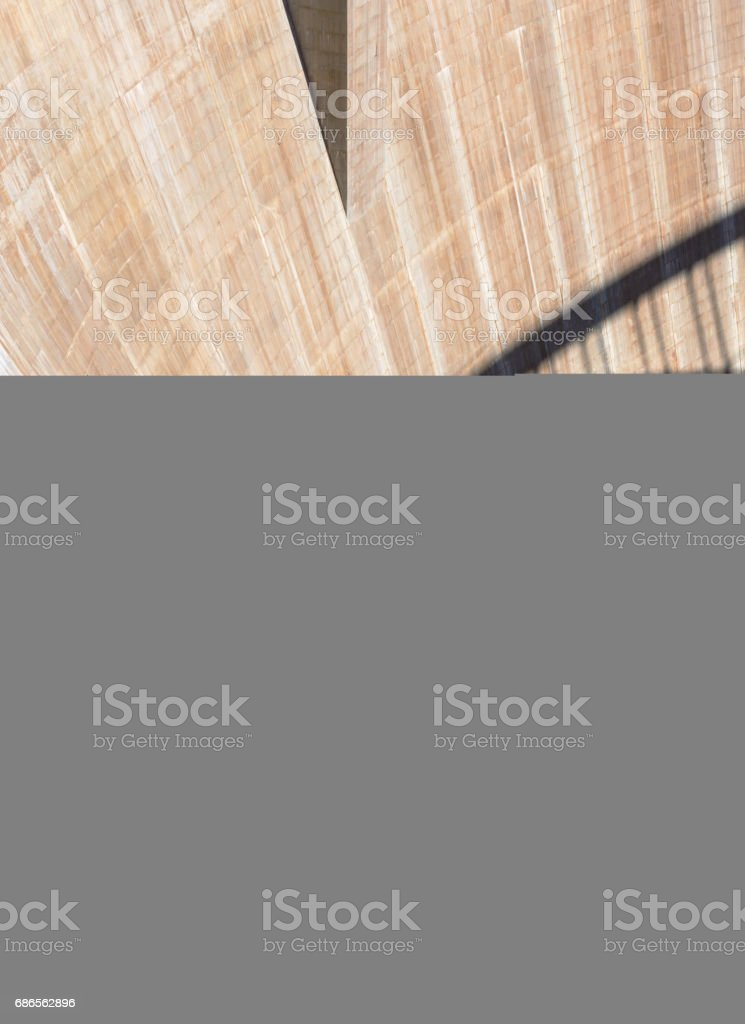 The wall of the dam with the shadow of the bridge on it royalty-free stock photo