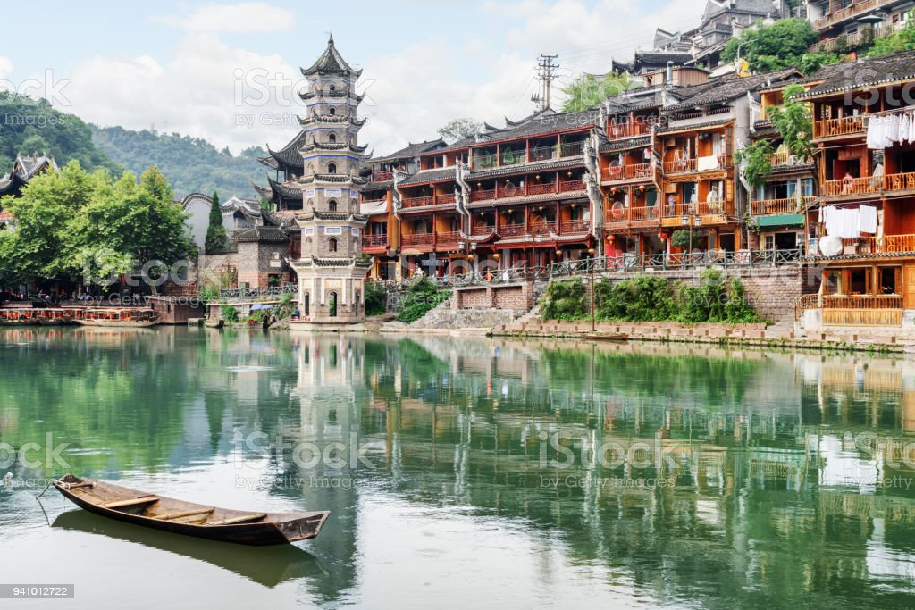 The Wanming Pagoda reflected in water of the Tuojiang River stock photo