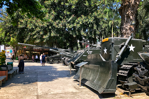 Ho Chi Minh City, Vietnam - February 11, 2019: Military equipment participating in the battles is exhibited in the courtyard. Tourists from all over the world visit this museum every year. The memory of the victims of the Vietnam War