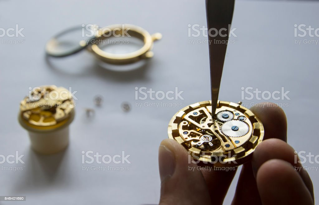 The watchmaker is repairing the mechanical watches in his workshop stock photo
